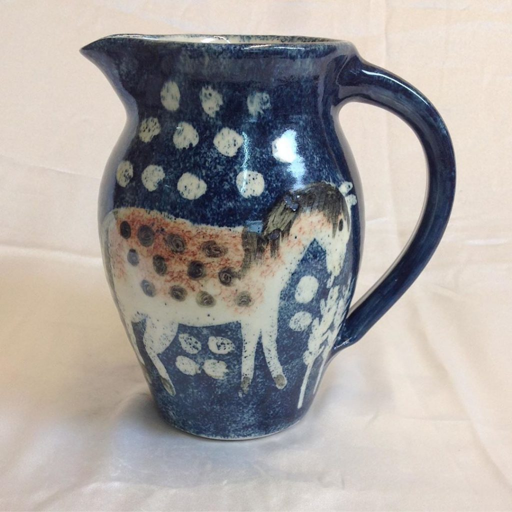 blue tall jug with horse design