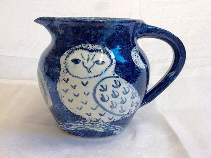 blue jug with owl design