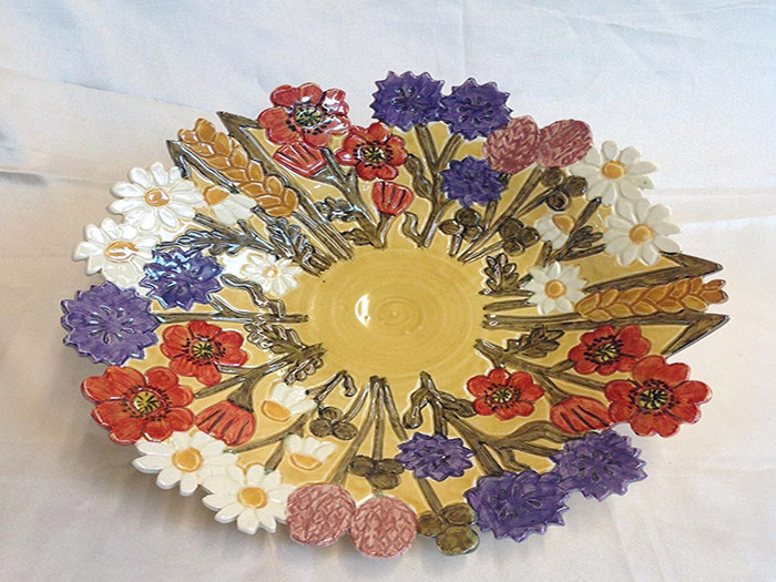 plate with multi coloured flower design
