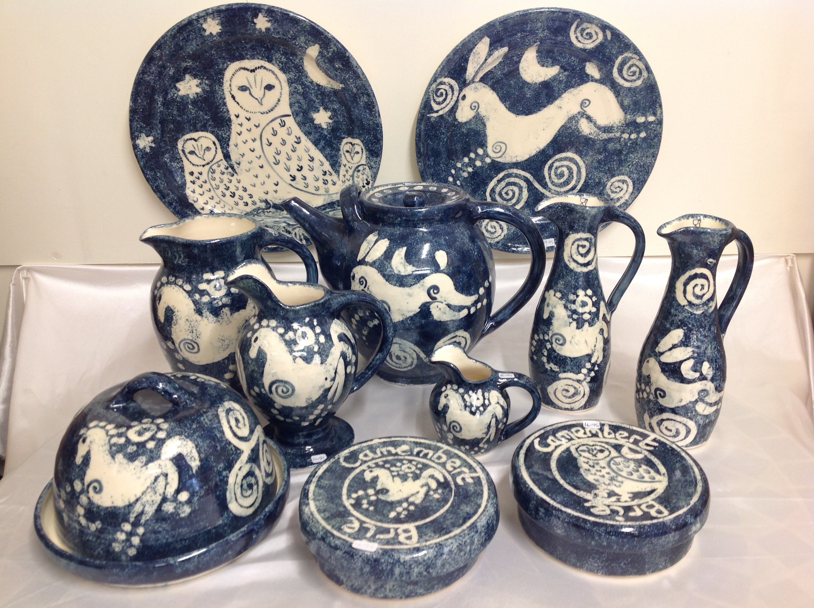 selection of pottery plates, jugs and dishes